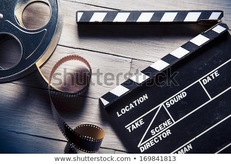 Cinema film and clap board Stock photo © montego