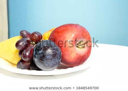 fresh organic summer berries mix in white plate on blue wooden table background raspberries strawb stock photo © denismart