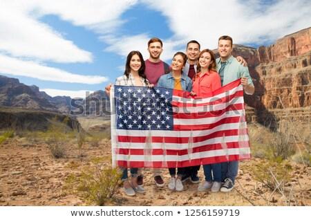 друзей американский флаг Гранд-Каньон гражданство группа улыбаясь Сток-фото © dolgachov