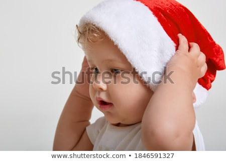 A boy with blond hair against the background of a Christmas tree lies on a sofa and dreams of the be Stock photo © ElenaBatkova