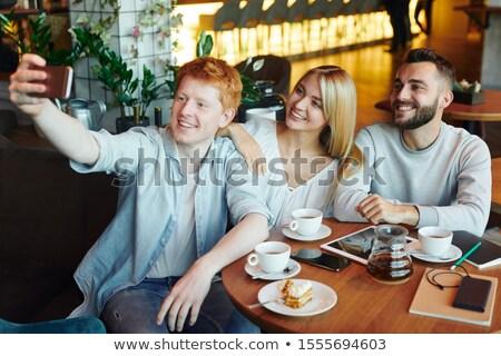 Három boldog fiatal szeretetteljes barátok készít Stock fotó © pressmaster