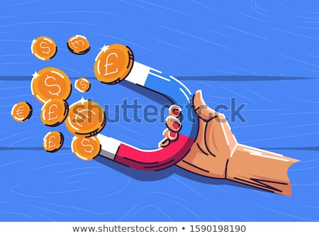 Businessman using magnet to attract money Stock photo © sgursozlu