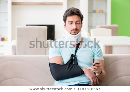 Młodych student człowiek strony szkoda posiedzenia Zdjęcia stock © Elnur
