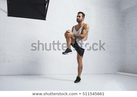 Handstand and knees Stock photo © mayboro