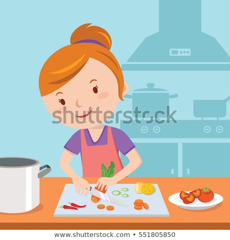 housewife preparing lunch and cutting carrot stock photo © vladacanon