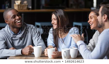 Woman Sitting in Coffeehouse and Drink Coffee Stock photo © robuart