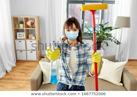 asian woman with window detergent and sponge mop Stock photo © dolgachov