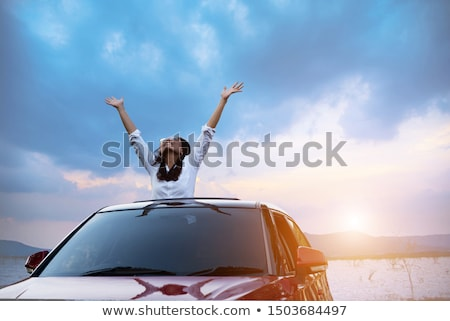 Asian car driver woman smiling happy relaxing in convertible car on summer road trip vacation. Trave Stock photo © Maridav