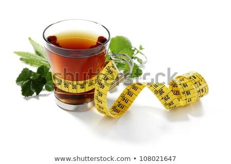 kruidenthee · beker · bloem · vrouwen · gezondheid - stockfoto © aelice