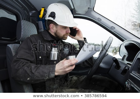 Construction worker talking on the phone Stock photo © photography33