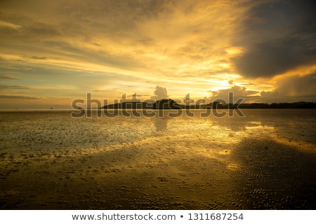view of a sunrise over ao nang beach krabi province thailand stock photo © moses