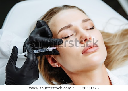 Woman receiving collagen Injection Stock photo © lovleah