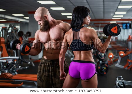 Muscular man with strong arms and nice abs Stock photo © stockyimages