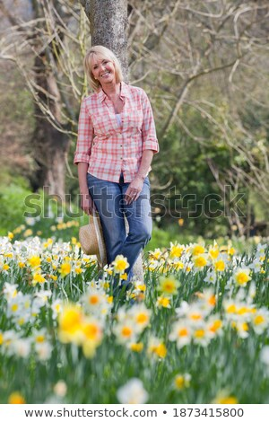 Portrait of woman in front of tree trunk Stock photo © photography33