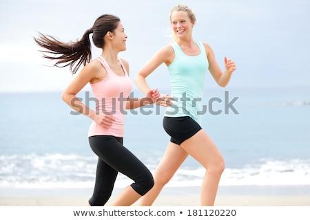 Vivacious laughing woman in water Stock photo © dash