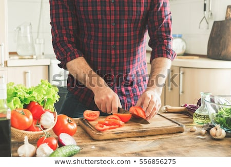 man cutting cucumber on the countertop stock photo © photography33