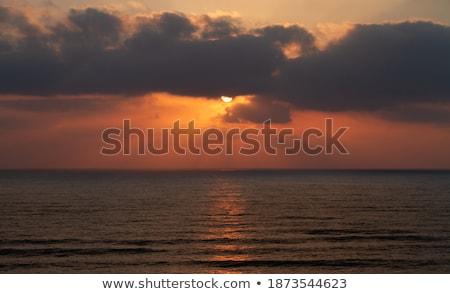 Boat on Sea at Sunset with Sunrays Stock photo © ildi