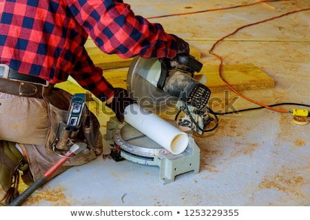 plumber sawing length of plastic pipe stock photo © photography33