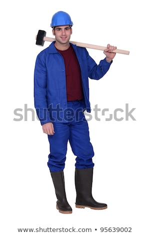 Man casually stood with sledge-hammer resting on shoulder Stock photo © photography33
