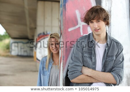 Young urban couple stood by wall Stock photo © photography33