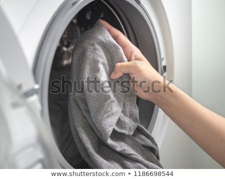 Caucasiano mulher lavanderia branco casa Foto stock © wavebreak_media