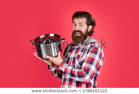 Chef holding saucepan Stock photo © photography33