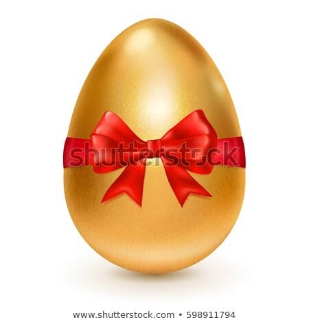 Nagy citromsárga húsvéti tojás színes szalagok vidám Stock fotó © vitek38