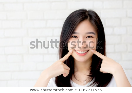 Bella donna toccare guancia dito primo piano ritratto Foto d'archivio © wavebreak_media