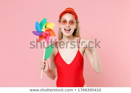 Happy woman in bikini holding pinwheel Stock photo © wavebreak_media