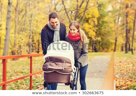 mother with baby walk on bridge autumn stock photo © Paha_L