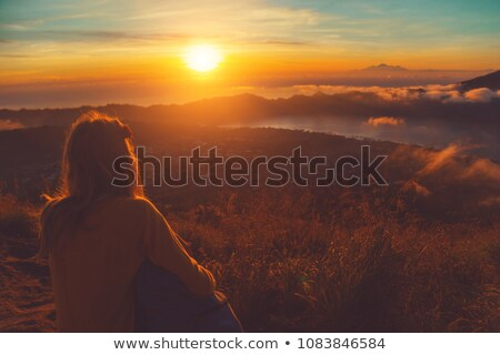 Sunset on the ocean - view of volcano Batur. Indonesia, Bali. Stock photo © pzaxe