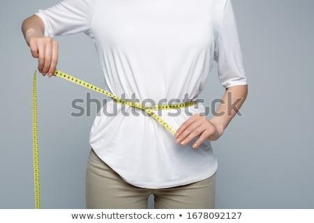 Woman measures her body Stock photo © Nobilior