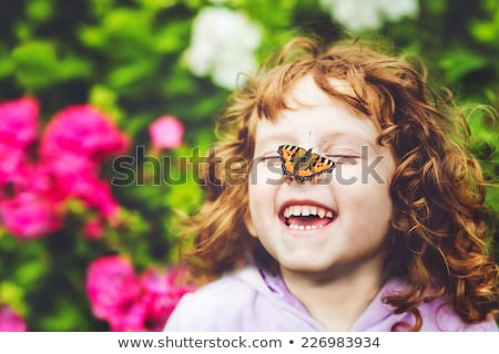Happy child with spring flowers Stock photo © ilona75