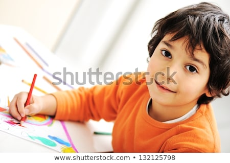 Cute young boy busy in drawing stock photo © get4net