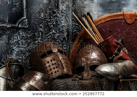 Stock photo: Medieval knight on grey background.