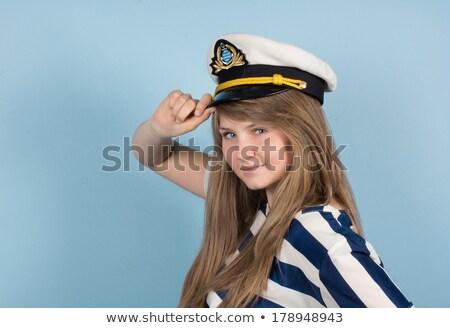Beautiful girl in captain's hat Stock photo © Nejron