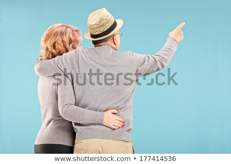 Rear view of a senior man showing something Stock photo © bmonteny