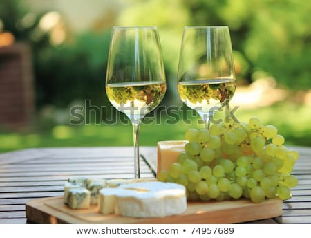 two glasses of white wine blue cheese and a grapes stock photo © manera