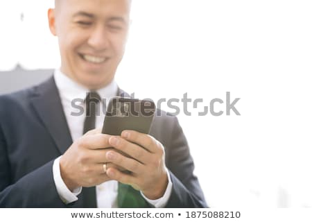 Stylish businessman chatting on his mobile stock photo © juniart