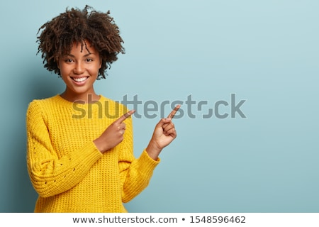 woman presenting a copy space pointing with finger stock photo © ichiosea