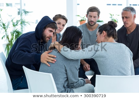 Woman comforting another in rehab group at therapy Stock photo © wavebreak_media