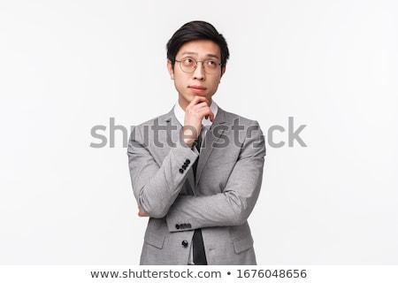молодые бизнесмен мышления стороны подбородок серый Сток-фото © wavebreak_media