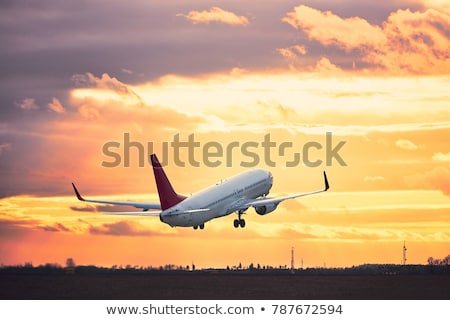 Stockfoto: Passenger Business Airplane Take Off And Flying In Sky Sunset U
