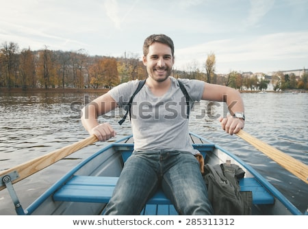 young man rower in a boat stock photo © smuki