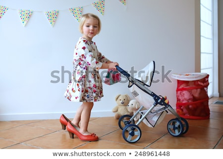 little girl with doll in carriage Stock photo © Paha_L