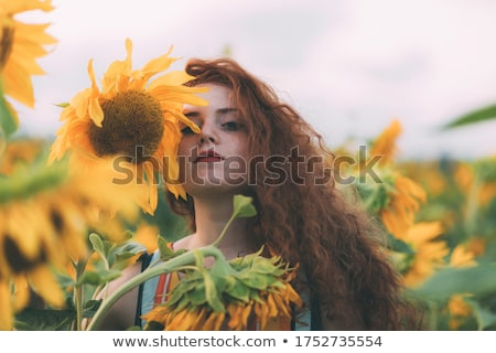 closeup portrait of young girl outdoors with sunflowers stock photo © paha_l