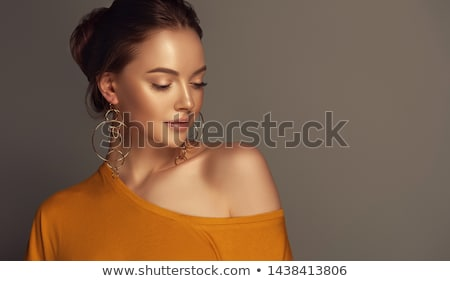 Beautiful young woman with silver jewellery. stock photo © lubavnel