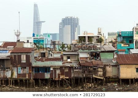 трущобы дома реке банка современных Сток-фото © smithore