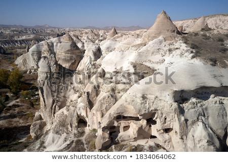 Houses carved into rock Stock photo © bezikus
