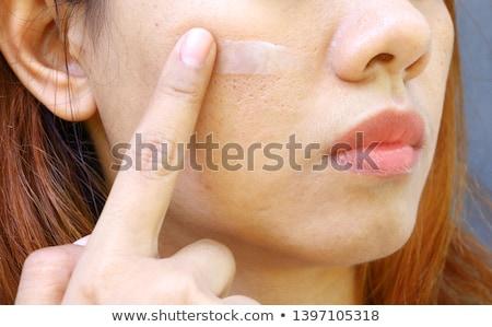 Attractive woman having white cream on her face  Stock photo © wavebreak_media